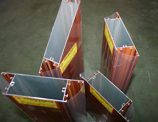 ALUMINIUM PROFILES FOR CASEMENT DOOR WITH WOODEN COLOR SURFACE.